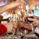 Teens holding wine glasses on purim